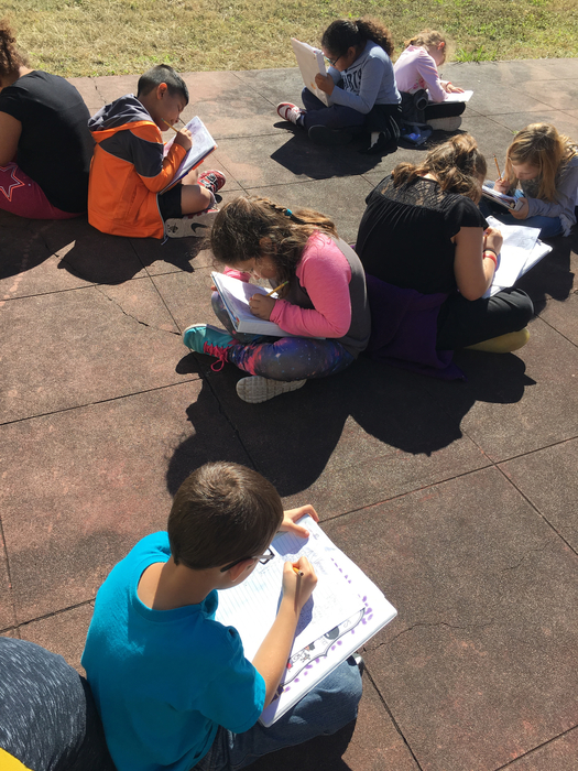 Spelling test outside-soaking up the sun!☀️