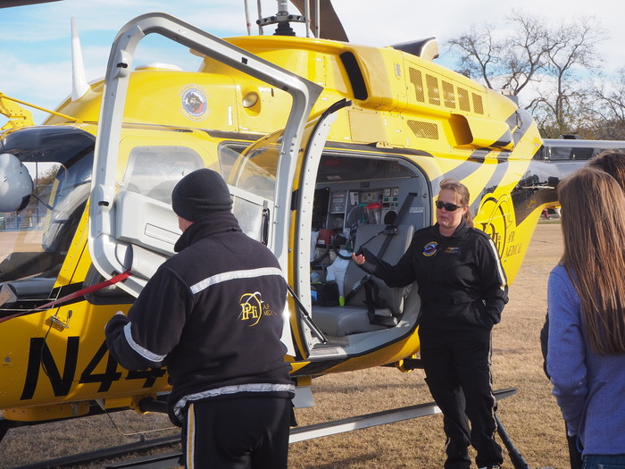 PHI paramedics show the students inside the helicopter.