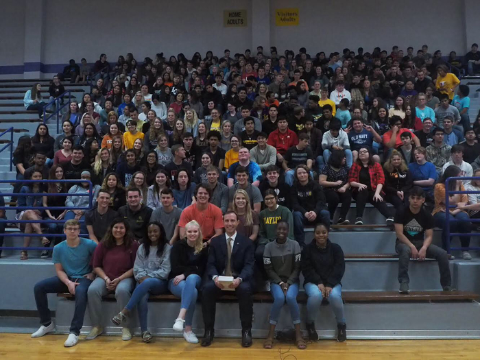 Lgisd students meet Secretary of State David Whitley at a special assembly today.