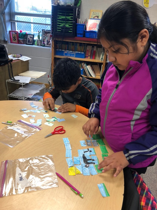 Hard at work assembling another student's puzzle.