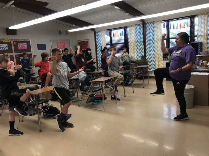 6th grade World Cultures learning some moves in Tai Chi with Mrs. McKee.