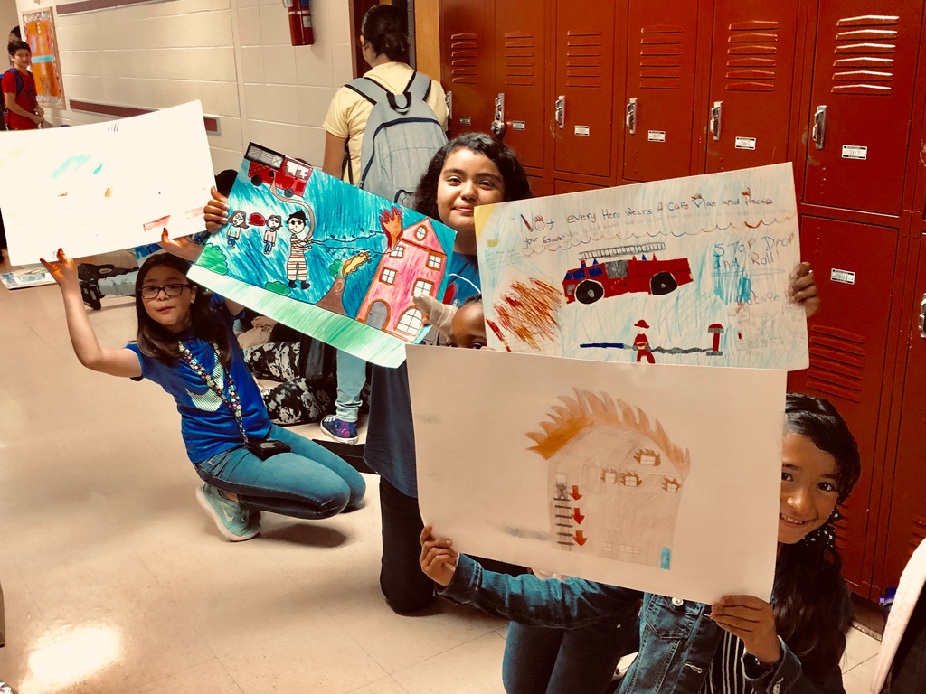 6th graders are ready to go with their Fire Prevention posters.