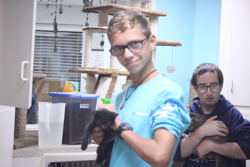 Students cuddled the cats at Gardenia Janssen Animal Shelter
