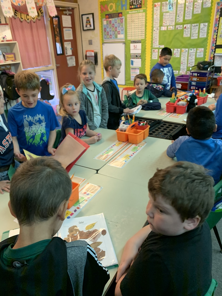 Second graders are sharing their leaf projects with the first graders!