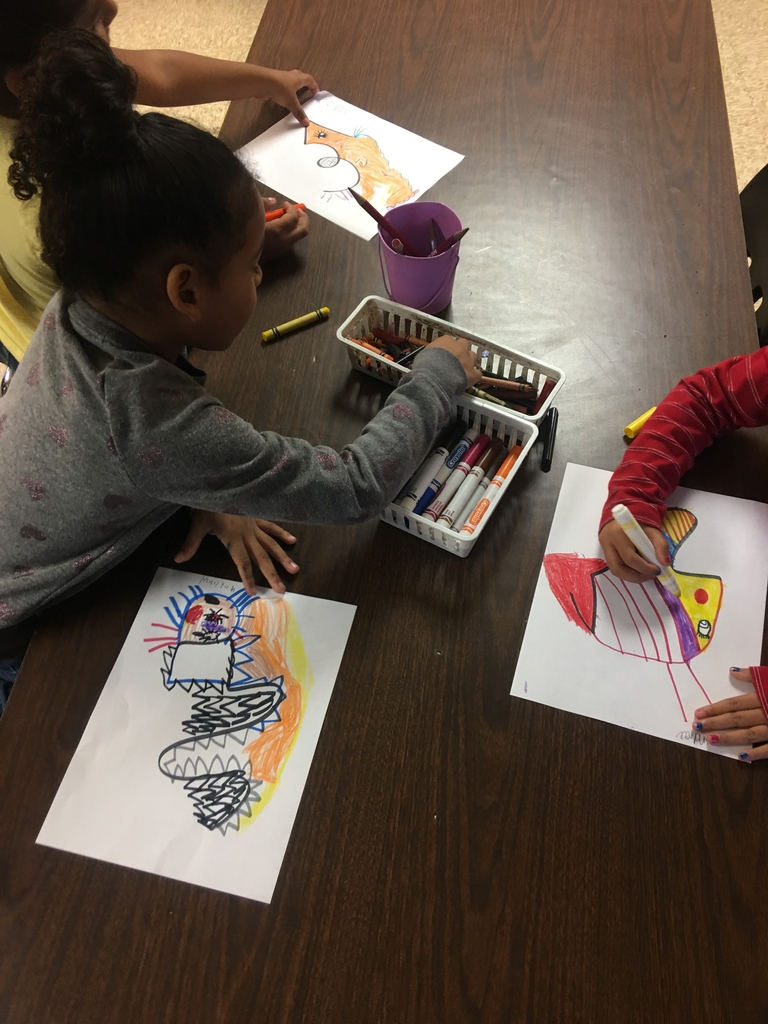 Kinder students creating art from a single random line.