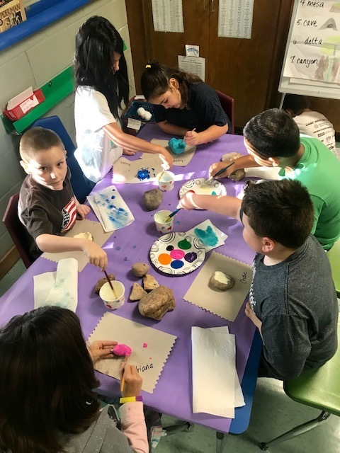 Mrs. Nichols' class hard at work painting rocks for World Kindness Day!