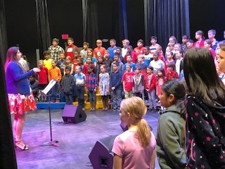 4th grade singing opening song at today's program.