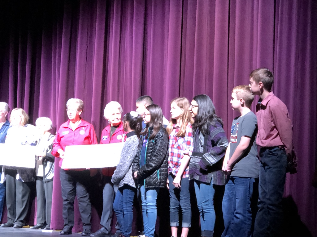 6th grade student council presentation of the penny wars check.