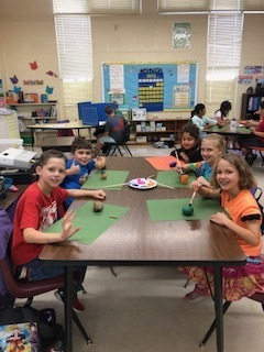 "Mrs. Johnson's class painting rocks for ""Kindness Day."""