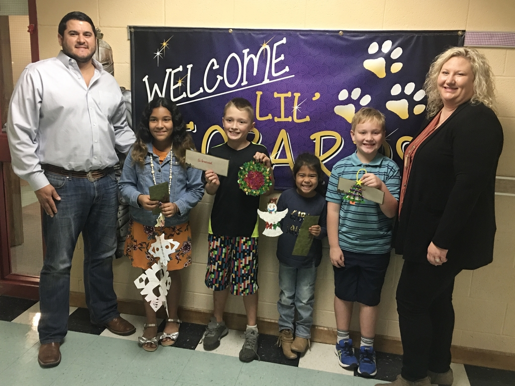 Left to Right: Phillip Adamcik (sponsor), Yaritza Romero (5th Grade), Eli Greenwood (4th Grade), Audelia Gutierrez (Kindergarten), Myles Dippel (2nd Grade), and Casey Harbers (sponsor)