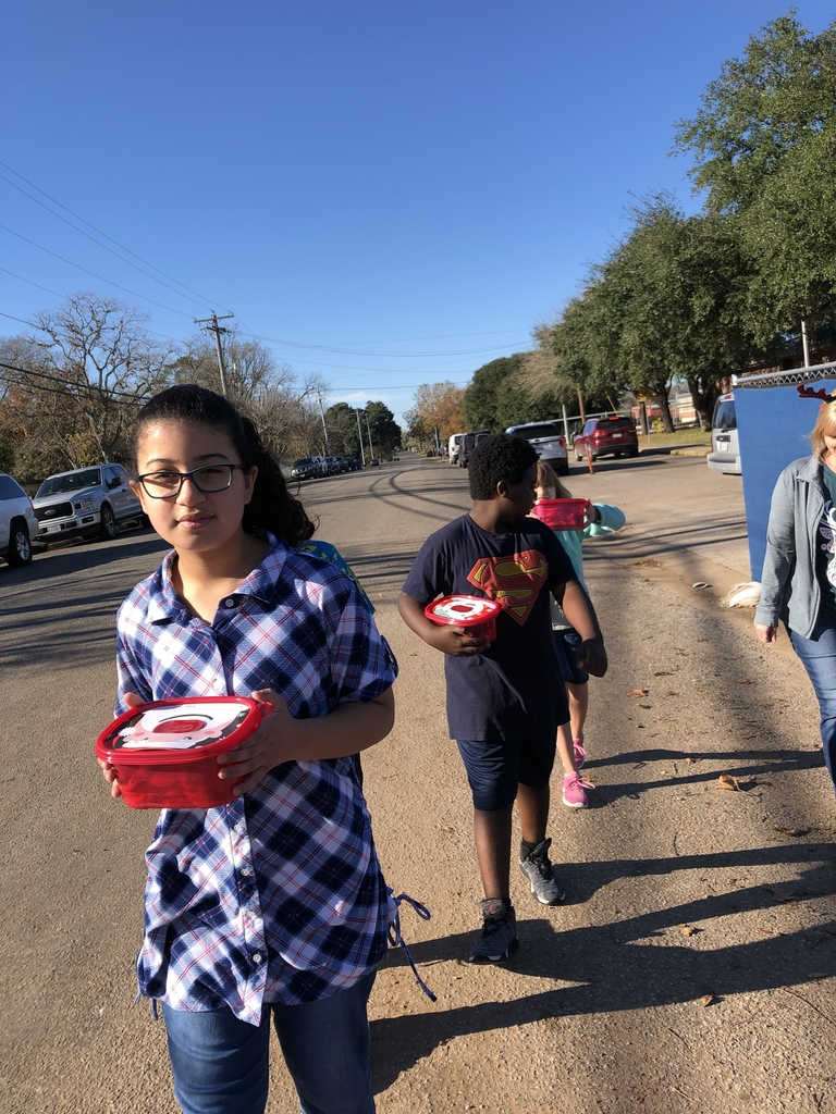 Walking with our homemade cookies to the police station.