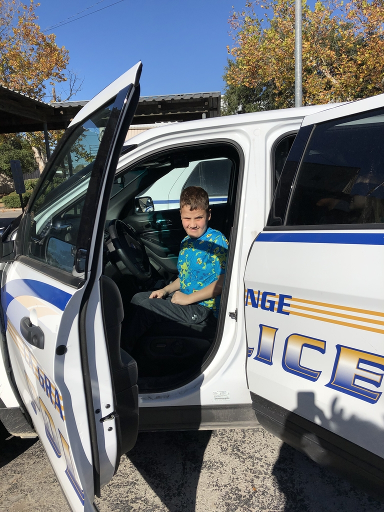 Dylan enjoyed seeing the inside of a police car. He said he was happy he wasn't in the back seat!