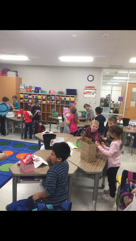 Ms. Matocha's class having fun passing out Valentine's Day cards!
